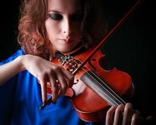 Violin playing violinist musician. woman classical musical instrument player  Kuvituskuvat