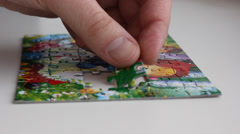 Collecting pieces of puzzle picture Stock Footage