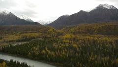 Pan Left Snow-capped Mountains, Fall Trees and River Foreground Stock Footage
