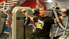 Man strengthens the pectoral muscles in fitness, gym. Workout  - stock footage