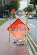 caution road street sign - stock photo