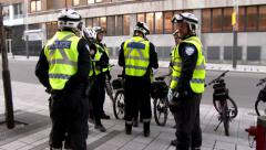 4K Police bicycle team on standby at protest Stock Footage