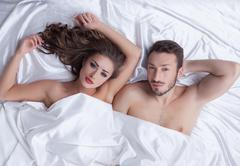 Stock Photo of Image of young heterosexual couple posing in bed