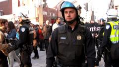 Riot police officers push back protesters Stock Footage