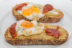 Closeup of Spanish Tapa with Fried egg and dry tomato Stock Photos