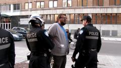 4K UHD - Riot police releasing handcuffed suspect Stock Footage