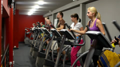 People doing sports, running on machines in fitness, gym. Fitness woman. Stock Footage