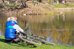 cyclist in the park pond - stock photo