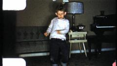 1950s boy dancing to Elvis record - HD 8mm film - stock footage