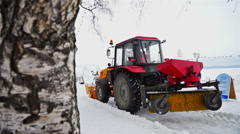 Snow-plough vehicle working at festival site Stock Footage