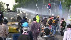 PROTESTERS RIOT POLICE WATER CANON Stock Footage