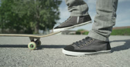 Stock Video Footage of SLOW MOTION CLOSE UP: Skateboarder picks up his skate