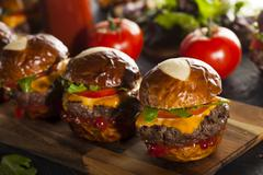 homemade cheeseburger sliders with lettuce - stock photo