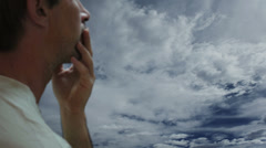 Concerned Man Against Timelapse Clouds - stock footage