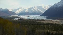 Glacier Valley, Distand Mountains, Autumn Forest Foreground Stock Footage