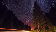 Star trails in the mountains forest road - moving stars timelapse - stock footage