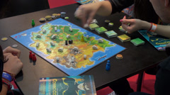 Children play tabletop game, board game, dice, cards Stock Footage