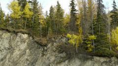 Pan Left Autumn Trees Atop Rocky Bluff Stock Footage