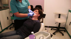 Woman patient on dental chair, dentist checking teeth, dental care Stock Footage