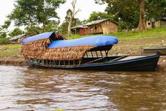 Boating on the river, peru amazon Stock Photos