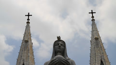 Time lapse of clouds behind Nortre dame cathedral and marble Virgin Mary Stock Footage