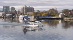 Twin Engine Float Plane Taxies in Victoria Harbor Stock Footage