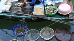 Fish market on floating boats in Ha Long Bay Stock Footage
