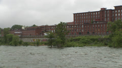 Merrimack River and Mill Buildings in New Hampshire - Rainy Afternoon Stock Footage