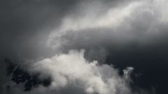 Storm clouds in Swiss Alps - time lapse - stock footage