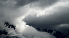 Storm clouds in swiss Alps - stock footage