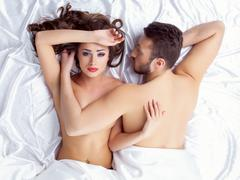 Image of weary young lovers lying on silk sheets Stock Photos
