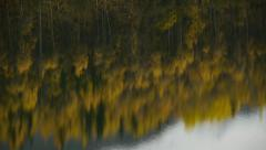 Tilt Sky Refection to Autumn Forest, Snow-Capped Mountain, and Sky Stock Footage
