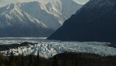 Tilt Blue Sky to Snowy Mountains and Icy Glacier - stock footage