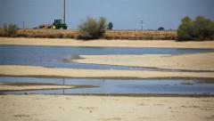 Tractor Passes Lakebed - stock footage