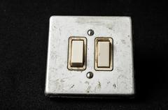 Light switch on black Stock Photos