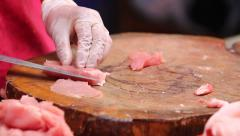 Pork chopping on wooden plate Stock Footage