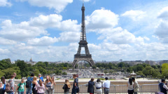 Tourists visiting the Eiffel Tower in Paris Stock Footage