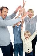 Jubilant family celebrating and partying indoors - stock photo