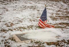 Veteran's Grave in a Rural American Cemetery in Winter - stock photo