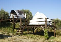 tents on stilts - stock photo