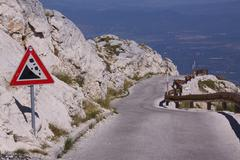 Mountain road in Dalmatia - stock photo