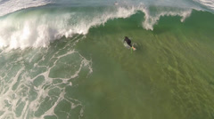 Surfer ducking waves Stock Footage