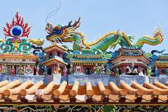 Dragon statues in Chinese style on top of temple roof Stock Photos