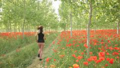 Sexy Young Woman Running outdoors activity springtime scenery spri Tracking shot Stock Footage