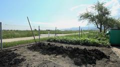 Farmyard manure in home garden Stock Footage
