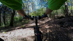 Mountainbiking  (POV) in a forest Stock Footage