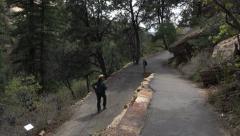 Mesa Verde Park Ranger on trail 4K 071 Stock Footage