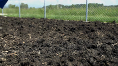 Gardener with boots walking on the farmyard manure Stock Footage