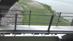 A fast train is crossing a Ganga river Bridge near at Allahabad Stock Footage