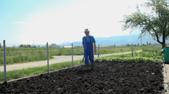 Gardener walking on the manure Stock Footage